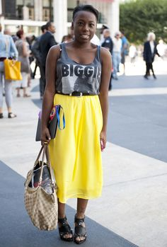 """Trend Watch: tee skirt.  We've all heard of the tee shirt, but I'd like to call this look the tee skirt.  Combining super casual and even masculine tee's with feminine tea length skirts looks edgy and casually chic.  Not my taste, but clearly a new """"thing"""""""