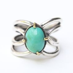 Natural blue/green turquoise ring in silver bezel and brass prongs setting with oxidized silver matte twist band