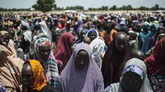 In this photo taken on September 2016 women and children queue to enter one of the Unicef nutrition clinics at the Muna makeshift camp which houses more than IDPs (internally displaced people) on the outskirts of Maiduguri, Borno State,. Boko Haram Insurgency, Human Rights Watch, African Children, Cancer Treatment, Red Cross, Marriage Promises, Lake Chad, Wednesday, Tuesday