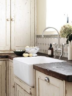 Love the distressed cabinets and countertop.