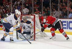 CHICAGO, IL - OCTOBER 12: Jonathan Toews #19 of the Chicago Blackhawks shoots against Ryan Miller #30 of the Buffalo Sabres as Mark Pysyk #3 defends at the United Center on October 12, 2013 in Chicago, Illinois. (Photo by Jonathan Daniel/Getty Images)