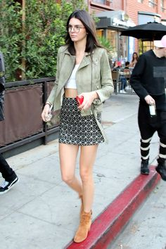 Kendall is giving us a lesson in geek-chic. The model spent the day out and about in L.A. wearing Garrett Leight specs with a skin-baring crop top and Related miniskirt ensemble, completed to autumn perfection with an olive leather jacket and Gianvito Rossi suede booties.    - MarieClaire.com