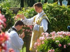 One of the newly ordained gives his first blessing to one of the seminarians