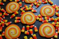 Candy Corn Swirl Cookies - The Simple, Sweet Life - - These candy corn inspired sugar cookies are decked out in true Halloween style! And best of all: they're every bit as tasty as they are easy to make! Halloween Cookie Recipes, Fun Halloween Treats, Halloween Cookies, Halloween Candy, Holiday Treats, Happy Halloween, Halloween Foods, Holiday Foods, Holiday Recipes