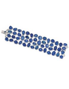 TANZANITE, SAPPHIRE AND DIAMOND NECKLACE, MICHELE DELLA VALLE Designed as five rows of graduated tanzanite beads, the clasp set with oval sapphires and accented with brilliant-cut diamonds, length of shortest row approximately 520mm, signed MdV, pouch stamped Michele della Valle.