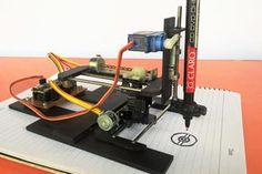 Woodworking Program Picture of DIY Arduino CNC Drawing Machine - Hello Guys, In this instructable I'm going to show you how to make an Arduino CNC plotter from old DVD writers. This is an amazing machine. You can make this mach. Arduino Cnc, Cnc Router, Servo Arduino, Arduino Motor, 3d Printing Business, 3d Printing Diy, 3d Printing Service, Machine Cnc, 3d Printing Machine