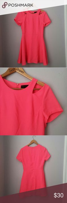 """Hot Pink Shoulder Cutout Mini Dress LG Gently worn - excellent condition! Poly/spandex. Some stretch. Back zipper. Bust 17"""". Length 32"""". Revolves Blaque Label.   Bundle for best deals! Hundreds of items available for discounted bundles! Bundle offers welcome.   Follow on IG: @the.junk.drawer Blaque Label Dresses Mini"""