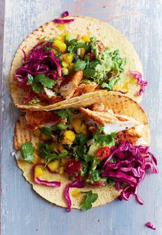 Mexican Corn Tortillas stuffed with Fish, Cabbage, Spicy Guacamole and zesty Mango Salsa - made the USA way. These BBQ fish tacos are one of our favourite Mexican inspired recipes from DJ BBQ. Enjoy on a mild summer evening or bake in the oven for a comforting winter meal.