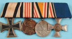 Rare Imperial German medal bar, as worn. Includes Iron Cross 1914 2nd class with rare non-combantat ribbon, Africa Colonial medal, China 1900 campaign and 20 year service cross. Red wool felt backing, brass pin back with open catch. A rare combination of medals, and one certainly from the First World War based on the overall age and ribbon construction.