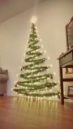 Easy Christmas Decor From simple to amazing Notable tips and tricks to form a fun and charming simple christmas decor diy xmas trees . Xmas image provided on this day 20190114 , exciting post reference 3707337813 Wall Christmas Tree, Noel Christmas, Diy Christmas Wall Decor, Xmas Trees, Tinsel Tree, Outdoor Christmas, Christmas Tree Made Of Lights, Christmas Tree Simple, Christmas Lights Outside