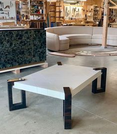 Here is some furniture in our workshop that are waiting for delivery. Our Chain table in parchment & horn, a green mica cabinet & a sofa. mica furniture, parchment furniture, artisanat français, savoir-faire, furniture makers, furniture designers, interior design, luxury furniture, super yacht interiors, french craftsmanship, bespoke furniture, designed by Jallu custom furniture, made in France, interior design inspiration