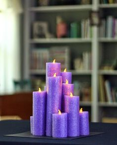 """Pool noodle """"candle"""" centerpieces for camp banquet. Using battery-operated flickering tea lights. Would be perfect for a pool party or kid's summer birthday party."""