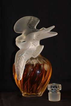 Lalique Nina Ricci LAir de Temps store display size perfume, figural stopper of bird in flight, signed Lalique France.  12 h.