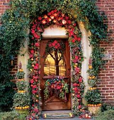 Incredible door garland. Also love the florals around the window in the door    Cold winter days are an asset for this display because they allow produce to stay fresh longer. You can replace the fruits and vegetables as needed, or set up the display right before a holiday gathering.