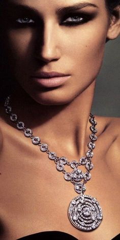 Glittering diamond necklace, not sure pf the hallmark.  but my guess is Bulgari maybe??