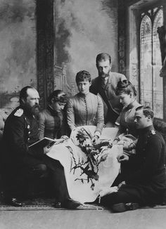 From left to right: Louis IV, Grand/Duke of Hesse; Princess Alix of Hesse; Pss Irene of Hesse; Grand Duke and Grand Duchess Serge of Russia; the Hereditary Grand Duke of Hesse. The three Princesses embroidering. Photographer: Carl Backofen.