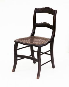 Mary and Abraham Lincoln often hosted dinners and parties at their  Springfield, Illinois home. This simple and light chair, one of a set of  six, would have...