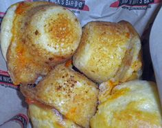 Jim N' Nicks Cheese Biscuits: Ingredients | 1 1/2 cup flour, 3/4 cup sugar, 3/4 cup shredded cheddar cheese, 3/4 cup 2% milk, 1 egg beaten, 4 1/2 Tbl. butter, 1 tsp. wildflower honey, 1 1/2 tsp. baking powder. Mix together everything except for honey & butter.  Seperately mash together honey & butter.  Then mix everything together.  Place in mixture in muffin tin & bake @ 400 for 15-20 min.
