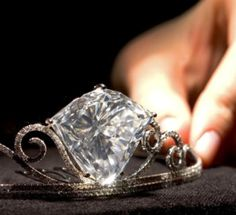 Alt view of Tiara with a shield-shaped diamond weighing 101.27 carats, set in brilliant-cut diamond extending scrolls, mounted in 18k white gold. The diamond is from the same mine as the Cullinan. www.christies.com...