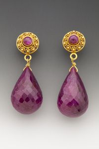 If you want to make an entrance, these just might do it for you. Impressively large faceted Burmese ruby drops on substantial 18K gold posts, each with a bezel-set ruby cabochon. (E70328B)