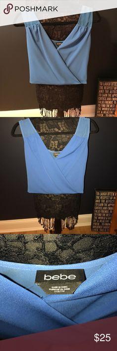 Bebe blue crop top Blue dressy crop top by Bebe , low cut v with sheer top and back , side zip for snug fit bebe Tops Crop Tops