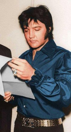 Elvis looking over a contract.