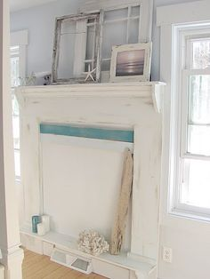 like the simple white painted empty frames and the starfish.... beachy : )