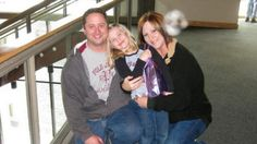 """""""This was taken at the Grand Rapids Museum in Michigan. I took this of my mom, my stepdad and my little sister. The funny thing is that I took a picture right after this one and it has nothing on it, but this picture has an orb and it looks like there is a face within the orb ... creepy!"""" -- EricaKayx3"""