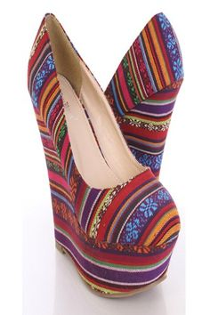 Very stylish wedges that features: Closed toe, multi printed throughout, and finished with cushioned footbed. 2 3/4 inch platform and 5 inch wedge.