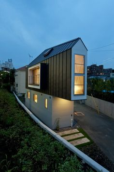 Site restrictions in Tokyo = River Side House.  http://freshome.com/2011/10/12/clever-small-home-architecture-derived-from-site-restrictions-in-tokyo/