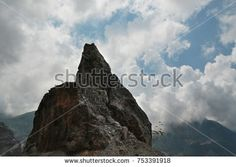 Alpine peak. Taurus mountain landscape with a rock at the level of clouds. Turkey.