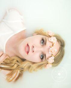 senior girl photography poses milk bath flowers