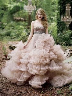 Dress: like a dream or a distant memory. My Grandmother made birthday cakes for me with a Barbie doll standing in it. The domed cake she was in was her dress; all covered with frosting....
