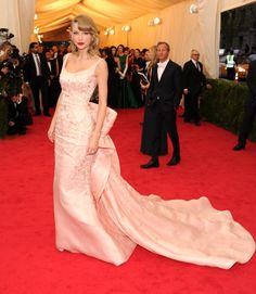 Pin for Later: The Star Wore Oscar: The Late Designer's Most Memorable Red Carpet Dresses Taylor Swift With a flair for drama and a serious train behind her, the singer couldn't stop sashaying along the red carpet of the 2014 Met Gala.