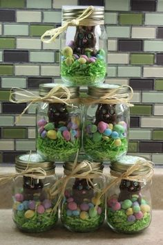 Easter treats in a jar. Fill the bottom of a jar with some Easter grass. Set a chocolate bunny in the middle and surround with chocolate eggs and jellybeans. Give one to each child!
