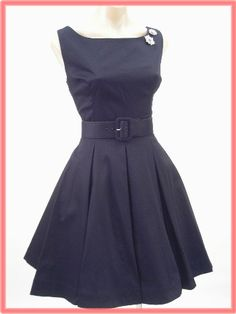 Simple retro dress...great style. With the right accessories and shoes, would be a showstopper!