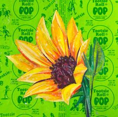 Yellow Wildflower, created with recycled candy and drink labels on a Lemon Lime Tootsie Pop Wrapper. #recycledart #recycledmaterial