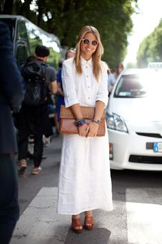 STREET STYLE SPRING 2013: MILAN FW - A long t-shirt dress and oversized clutch look equally ready for the Italian Riviera or the city.