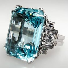 Vintage Aquamarine Cocktail Ring w/ Diamonds in Platinum  I really don't care if Aquamarine was worthless as far as being a gem or jewel is concerned.  I find the color and clarity of this cut and polished stone to be beyond comprehension. To me, it is one of the most beautiful natural creations of our Earth.
