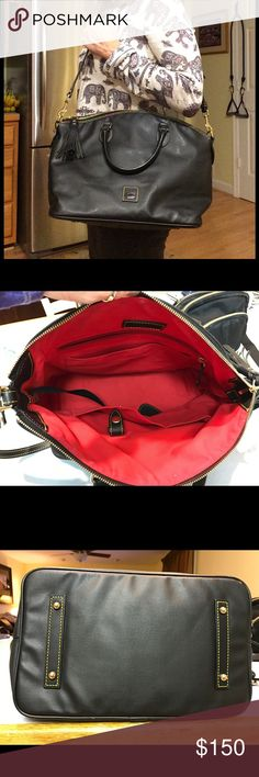 """Dooney and Bourke Black Satchel Coated cotton black Satchel.  Red interior with attached strap key holder - see second photo for interior view.  Gold hardware with 4"""" drop handles and 13"""" adjustable strap so you can carry it multiple ways.  In excellent condition with no interior stains/marks and exterior is in perfect condition.  Genuine Dooney and Bourke bag.  Dimensions: 14"""" W, 10.5"""" H. Dooney & Bourke Bags Satchels"""