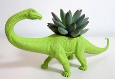 Cool planter for a kids room! Upcycling old toy for decoration and also functions as a natural air purifier!
