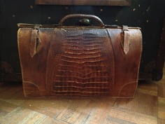 Get a Vintage Brief or bag to complete your look at MidNorth Mercantile this bag retails for $100.00 Vintage Alligator Skin!
