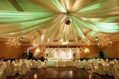 Elegant draping that leading to a disco ball?you know there's going to be dancing at that wedding!