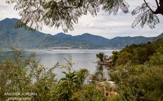 Lago Atitlan (Lake Atitlan) is travelling heaven. A stunning lake, a majestic volcano with it's crown of clouds, friendly people & wonderful cafes Volcano, Heaven, Clouds, San, River, Adventure, Mountains, Street, Outdoor