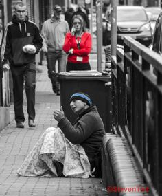I found this image disturbing. It is a juxtaposition from between nothing and others having everything, and yet he still manages to give a thumbs up on a cold Belfast day.https://www.flickr.com/photos/spudtait/shares/m9vPb3 | steven tait's photos