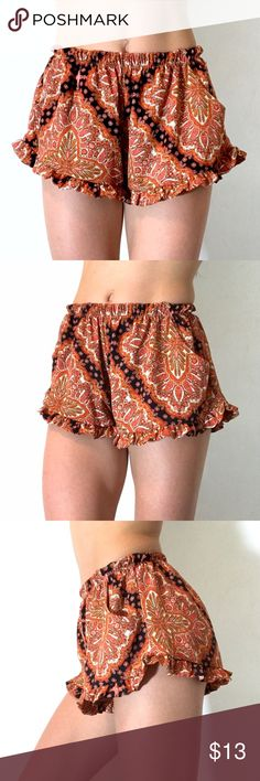 HONEY PUNCH PAISLEY FLORAL RUFFLE CHIFFON SHORTS S Really cute light weight flowey shorts with a beautiful orange paisley design. The waist band is elastic and the fit is very comfortable. The little ruffled hem line makes them super flirty and feminine and they even have pockets. Size small Honey Punch Shorts