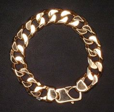 This is a CU350 or Bevelled Cuban Chain. The catch is a cast hand finished spring catch made specifically to suit this size/style of chain link. The image is of a 9 carat yellow gold bracelet. This is available in other alloys such as 9 carat white gold and can be made in alloys up to 18 carat Gold. Colours available are yellow , white and rose gold. See more info here - http://morrisandwatson.com/chain/
