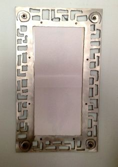 mirror frame..nice..done with metal for $400 but maybe could diy with something else painted like this...wood cut out, cardboard, etc??
