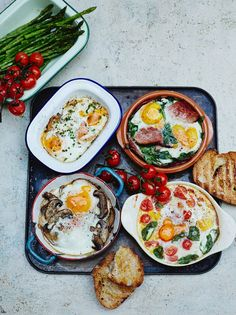 Baked eggs – lots of ways, Jamie Oliver's take on baked eggs. Spinach and ham, tomato and basil, smoked salmon and chives, and truffle mushroom. Can't wait to try them all!