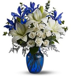 Irises with blue vase - centerpiece